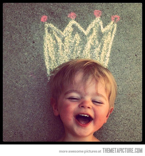 kid laughing with crown